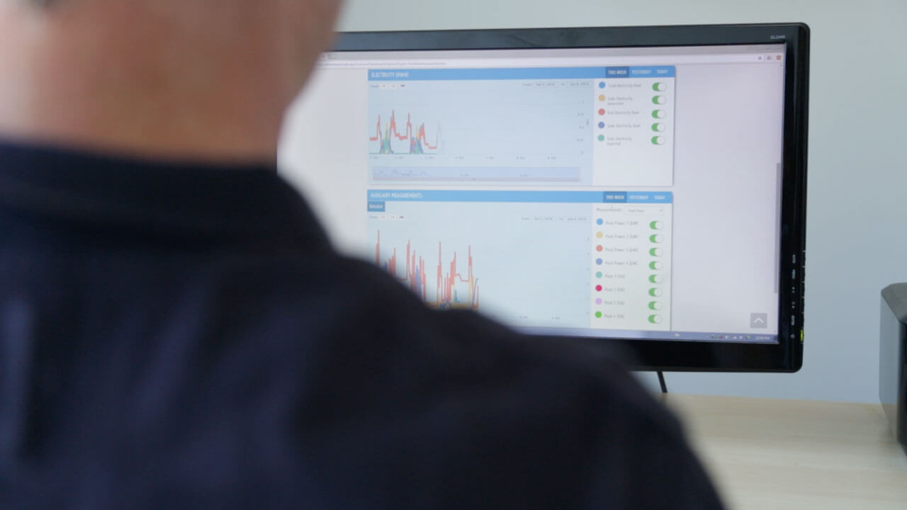 Man looking at carbonTRACK dashboard