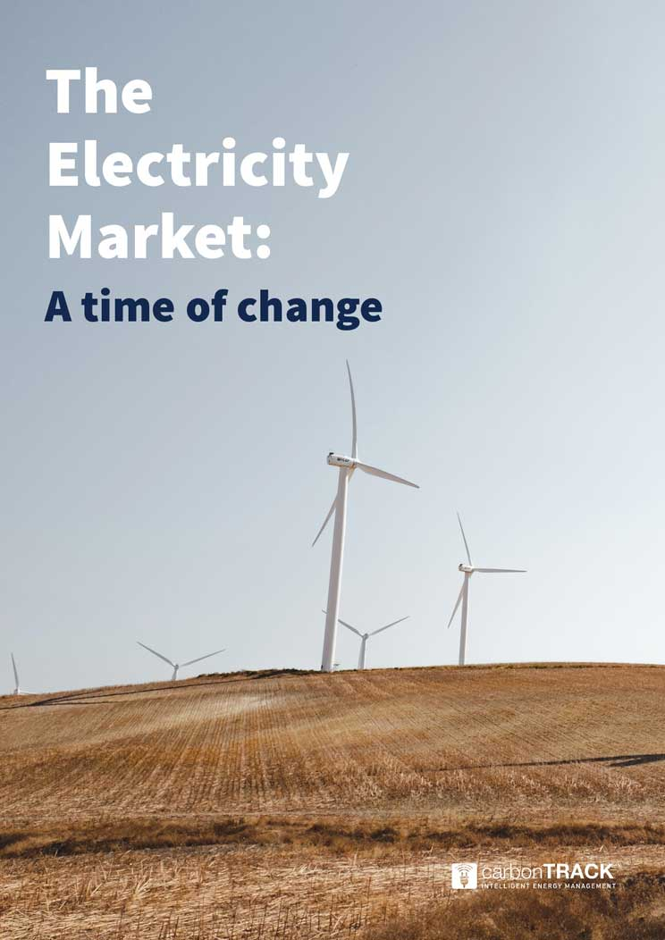 Cover of the electricity market white paper, showing a field on a sunny day, with wind turbines beautifully scattered across the horizon line.
