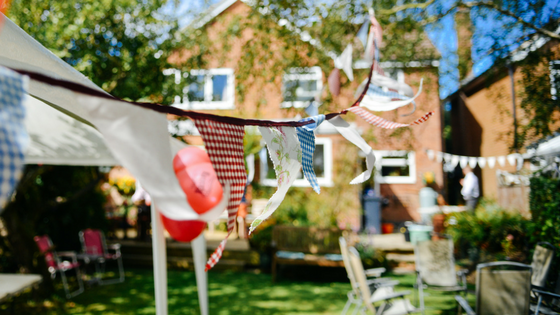 Sunny backyard with flags hanging