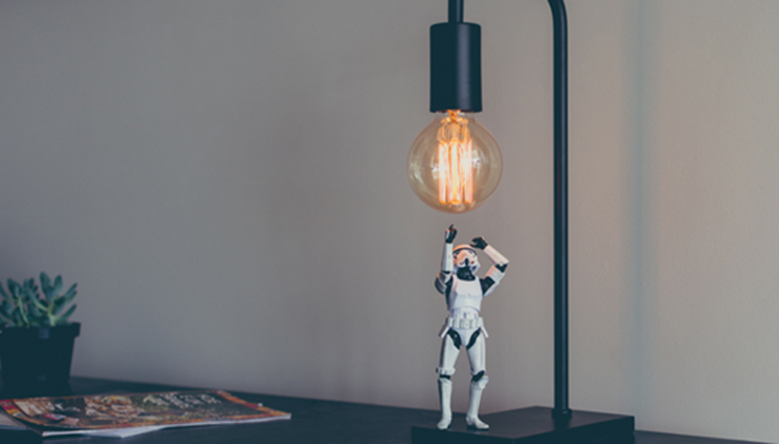 storm trooper toy reaches for light bulb