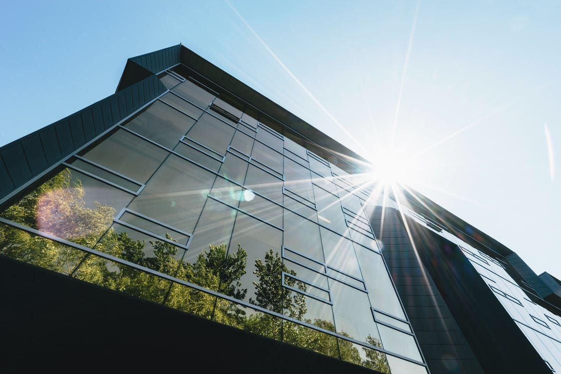 Passive solar energy warms the outside of an apartment building