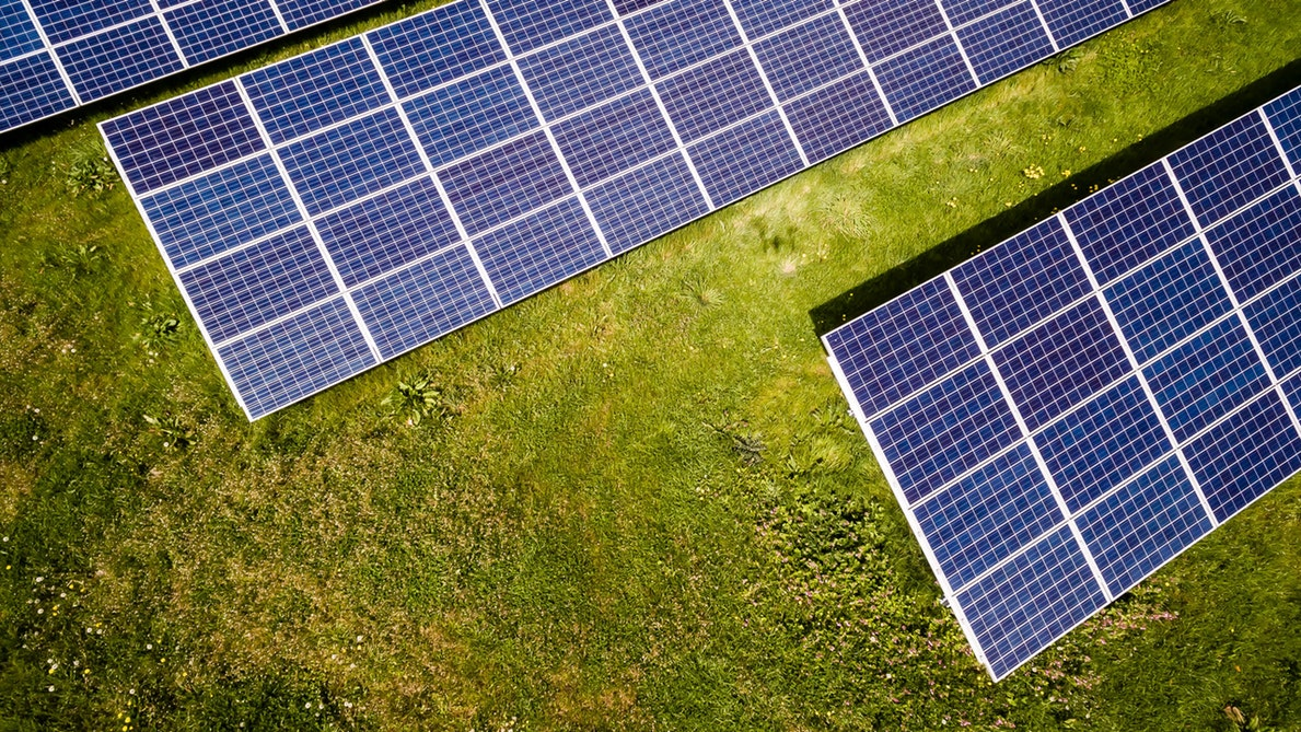 Solar panels and inverters on grass